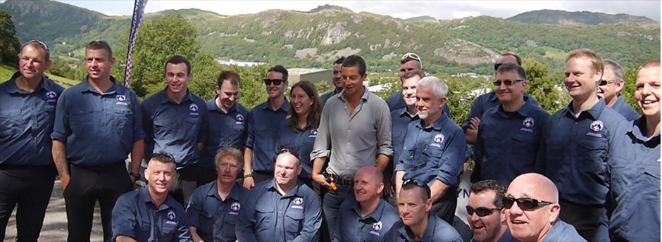 Team members with Bear Grylls at our new Base